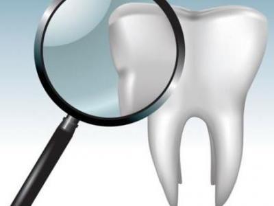 Imagem mostra desenho de lupa analisando dente