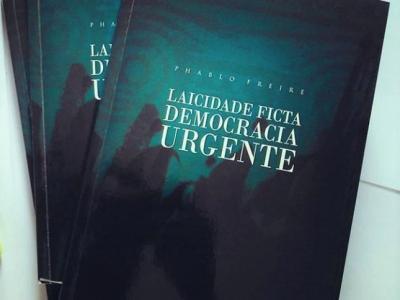 Imagem mostra livro do evento