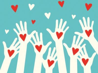 Imagem mostra mãos brancas com corações vermelhos
