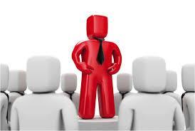 Imagem de um boneco vermelho liderando outros bonecos brancos